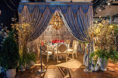 Inspired by a tented folly on the grounds of France's Château de Groussay, Bronson van Wyck creates a whimsical table for DIFFA's Dining by Design event
