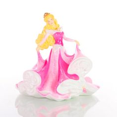 This stunning Sleeping Beauty figure from the English Ladies Co will be the jewel of your collection! Expertly crafted from bone china, Aurora wears a grand, sweeping gown, hand finished with Mother of Pearl lustre.