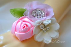 This is a beautiful triple flower wrist corsage. Flowers are made from chiffon and satin fabrics. and embellished with rhinestones and pearls.