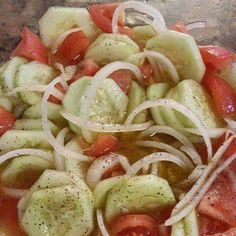 Cucumber, Onion, and Tomato Salad! 3 Tomatoes, 3 cucumbers, 1 onion, 1/2 cup apple cider vinegar, 1 teaspoon of cracked pepper, 2 table spoons of sugar (TOTALLY YOUR CHOICE... Me, I say without), 2 teaspoons of salt, 1 cup of water, 1/4 cup of olive oil, mix well...that's it. Let it chill for 1-2 hours... That simple......