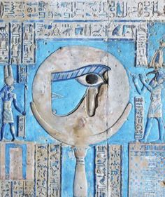 A painted relief of the sacred eye of Horus at the ancient Egyptian temple of the goddess Hathor at Dendera, Egypt.