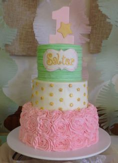 Pink and Mint Green Buttercream 1st Birthday Cake.  3 tier buttercream cake with all edible fondant decor. Name plate, number ONE topper and tiny gold stars all formed from fondant and painted with EDIBLE gold luster dust.