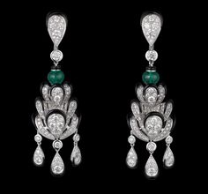 Indian Influences – High Jewelry Earrings White gold, two cabochon-cut emeralds, black lacquer, brilliants.