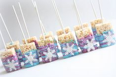 Delicious custom Chocolate dipped Rice Krispie Treats topped with handmade edible snowflakes! Great for a Frozen Birthday party dessert or