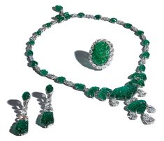 Bayco Carved Emerald Set set consisting of necklace, earrings, and ring made of mogul hand carved emeralds and rose-cut diamonds