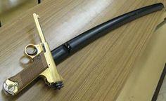 Samurai sword with nambu pistol as handle grip