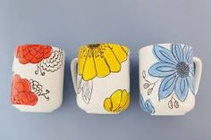 Coffee Mugs With Hand-Drawn Flowers shows you how to decorate a coffee mug using ceramic paint and bold floral designs anyone can do.Decoration Decoration may refer to: Pottery Painting, Ceramic Painting, Diy Painting, Painted Coffee Mugs, Hand Painted Mugs, Painted Cups, Diy Becher, Coffee Cup Crafts, Diy Mugs