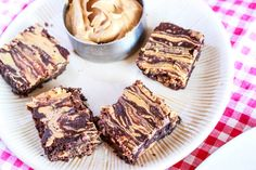 Skinny Peanut Butter Swirl Brownies! Gluten-free, made with whole-grain oats, no flour, no butter, no oil, and with a ton of sugar substitute suggestions!  These are so fudgy, you won't miss the unhealthy ingredients!
