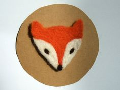 A lovely, needle felted fox brooch, designed and made by me in red wool felt, creamy ethically sourced merino and orange corriedale wool fibre.