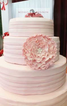 The cake was layered with horizontal stripes of fondant, and topped off with a large beautiful ruffle flower.