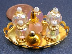 Miniature Bedroom Accessory Scent Bottles On A Metal Tray