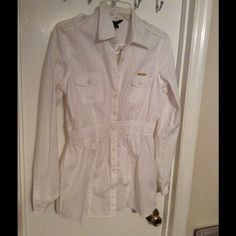 New white long sleeve top New long sleeve button up white shirt. Has elastic around the waist, the bottom is loose and flattering. Could be work with pants or leggings. Has small rocawear good plate on front of shirt. Rocawear Tops
