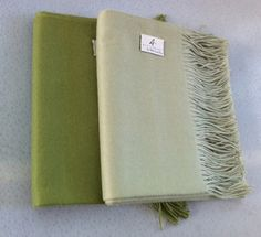 100% Baby Alpaca throws.  Absolutely the best way to stay warm.  Naturally hypo-allergenic.