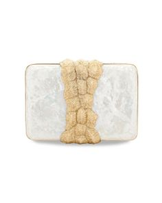 "Mother of Pearl Tortuga Clutch by Emi Jorge. Completely crafted by Filipino artisans, the minaudières are a completely tactile endeavor for the the former shoe designer: ""Because of the raw material I'm using, it's fascinating to be able to create surfaces and textures, and gratifying to see each process or layer unfold into something simply remarkable to see, touch and hold."" Check out her work at http://emijorge.com/."