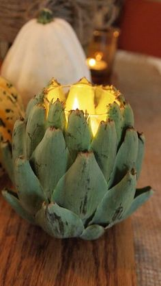 This artichoke candle holder adds interest to this fall-themed breakfast table.