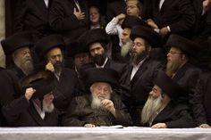 Credit: Menahem Kahana/AFP/Getty Images Ultra orthodox Jews belonging to the Vishnitz Hassidic sect gather around their Rabbi as they celebrate the Purim in Bnei Brak, a religious town near Tel Aviv