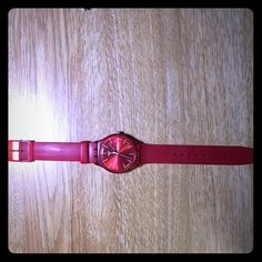 SWATCH water-resistant watch in red A nice watch from famous Swiss watch making brand SWATCH! In nice bright red color, made of really soft material to last a long time! The battery is dead thou. Swatch Accessories Watches
