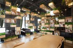 recycled steel bars form modular café interior by penda in beijing