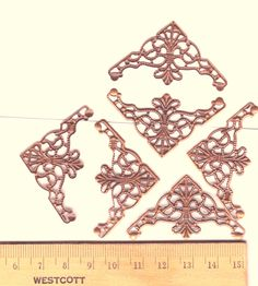 Antiqued copper plated filigree-  jewelry findings supplies - Corner shape - metal lace- lacy bendable wrapping delicate filigree findings. $2.75, via Etsy.