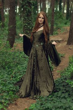 Green velvet dress. Lovely for walking in the woods, down by the old mill, along the battlements of old castles, etc.