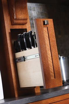 Keep your cutlery collection close at hand in a pull-out storage solution next to the cooking area or prepping area of your kitchen. - Dura Supreme Cabinetry