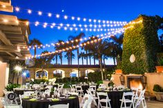 Our stunning Garden Terrace captured by E3 Photography. Our romantic market lighting and ivy covered fireplace offer the perfect setting for an outdoor reception. #carlsbadweddings #outdoorreception #beachwedding #hgiwedding #sandiegowedding #weddingreception #marketlighting