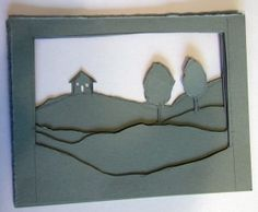 Paper layers....although this is more three-dimensional, I like the monochromatic layering idea for a card.