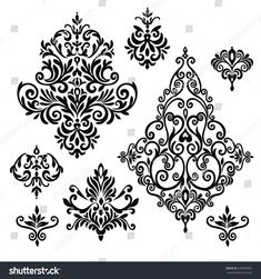 Set of five ornate foliate and floral design elements in black and white for retro design