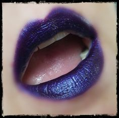 This purple hybrid is called War Cry and is a deep purple with a bright pink undertone (that WILL stain your lips pink) topped with a glitter that shifts from purple to blue. This gives it a glowing look that has to be seen to understand! It looks more blue in the photos because of this glitter. This color is amazeballs!  This War Cry is a hybrid dupe of a lipstick we used to carry with the same name…