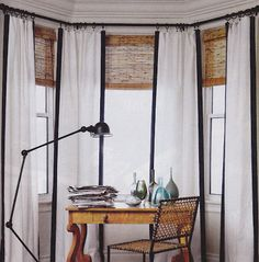 Navy trim curtains + bamboo shades