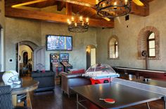 When planning a Game Room, don't forget the pinball, foosball, shuffleboard, ping-pong, poker table, and tv...