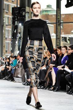 "Hugo Boss, New York Fashion Week Fall 2014. Calf length pencil skirt in a ""digitalized plaid"" pattern, black simplistic long-sleeved pullover top, black flats. So chic!"