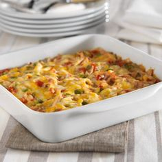 A creamy chicken and cheese casserole with bell pepper, onion and spicy tomatoes