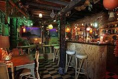 Diggin the bamboo designs in the bar of this great basement tiki lounge. And why do all tiki bars seem to have glass balls and lanterns hanging from the ceiling?