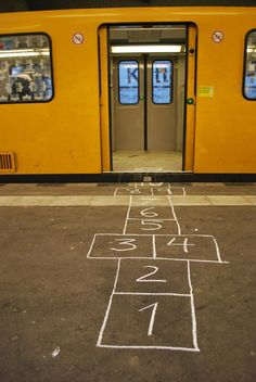 hopscotch subway. Good idea...  I'm going to copy this and draw one leading up to my front door!