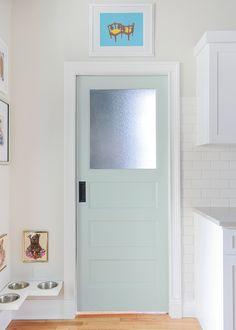 Kitchen pocket door color:  Swept Away by Benjamin Moore.  Cute little doggie corner.