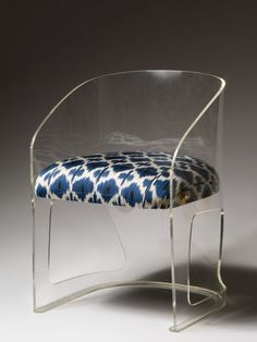 10 Ways to Bring Spring Home: A Bold Accent. Chair uphostered with Madeline Weinrib ikat