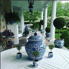 Blue and white theme on porch - pots of tiny topiaries, boxwood & fern - Carolyn Roehm Blue And White China, Blue China, Porches, White Porch, Pergola, Enchanted Home, White Planters, White Houses, White Decor