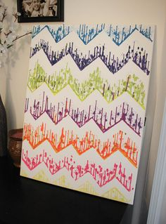 DIY Chevron Art Using Crayons, a glue gun and tape! Cool project!