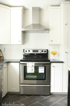 Kitchen Remodel: IKEA Cabinets And Range Hood, Honed Black Granite  Countertops, White Penny. Tile Floor ...