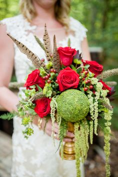Rose and feather centerpiece | Crystal Reyns Photography | see more on: http://burnettsboards.com/2015/10/vintage-boho-riverside-wedding/
