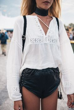 Thick black velvet choker and white foley peasant top with black lace up leather shorts