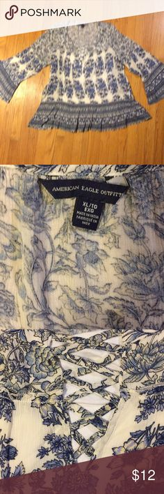 American Eagle Outfitters Peasant Top XL Peasant top with laced V front, flouted hem and sleeves, beautiful navel and ivory floral print. Gently worn- in great condition! American Eagle Outfitters Tops Blouses