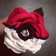 Perfect gift for nerdy couples or friends - hand painted Pokeball on a fake rose with acrylic paint