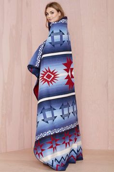 Wrap yourself up in this exclusive Pendleton design inspired by star images of ancient sky watchers.