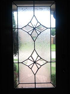 Broken leaded glass window.