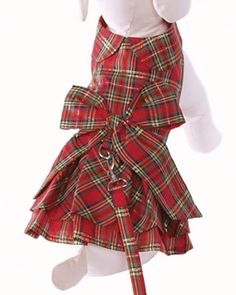 We love that this fashionable dress also serves as a walking harness! The Plaid Christmas Holiday Dog Dress & Leash from Cha Cha Couture is a high-quality cotton plaid layered dog dress with Velcro closures at neck and belly. The sturdy d-ring on the back allows for the included leash to be attached with ease! Fun details like scalloped collar and giant red plaid bow complete the look! This dress is perfect for holiday gatherings or really any occasion all year long!