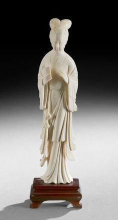 "Chinese Ivory Carving, early 20th century, standing female figure holding a fan, h. 8""."