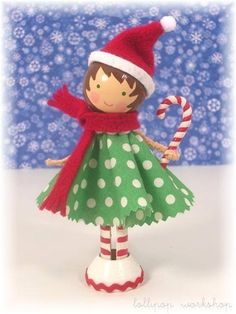 This sprightly little Lolli was sent by Santa himself to spread holiday cheer throughout the year! She loves to sing and nibble on Wood Peg Dolls, Clothespin Dolls, Christmas Projects, Holiday Crafts, Clothes Pin Ornaments, Noel Christmas, Christmas Ornaments, Illustration Noel, Little Doll