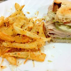 Spicy garlic rosemary parmesan truffle fries and pesto black pepper roasted turkey on toasted french bread :) MONEY! Who needs fancy Philippe when you've for me!